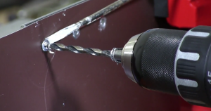 adding pressure to a spinning rivet