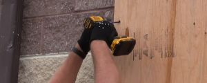 screwing masonry screws into the hurricane protection