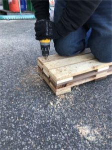 Drilling Holes in Pallet Shelves