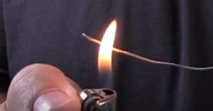 using a lighter to heat up the insulation around a copper wire